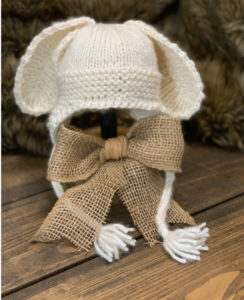 Little Bunny Hat crochet baby bunny hat pattern on hat stand with burlap bow